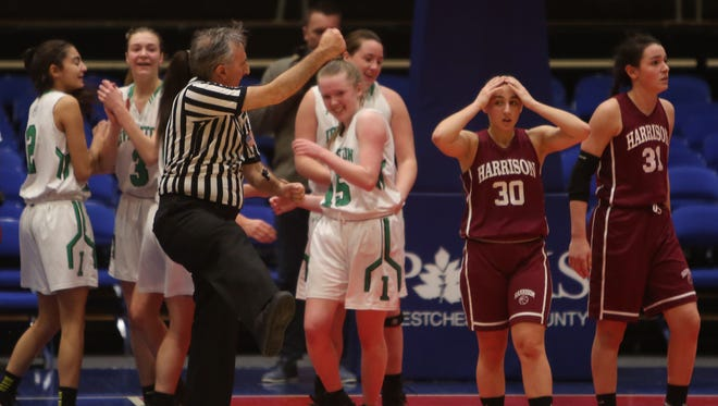 Irvington's Lindsay Halpin (15) reacts after make the shot and being fouled by Harrison's Stevie Carpiniello (31) in the final seconds of the challenge game in the Slam Dunk Tournament at the Westchester County Center in White Plains Dec. 26, 2015. Irvington won the game 57-55.