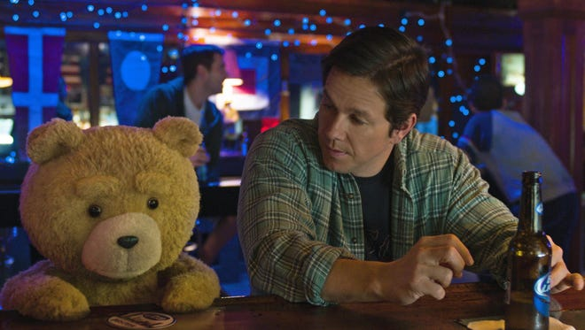 """Ted, voiced by Seth MacFarlane, left, and Mark Wahlberg star in """"Ted 2""""."""