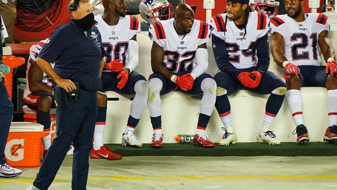 New England Patriots head coach Bill Belichick looks on from the sideline during the second half against the Kansas City Chiefs at Arrowhead Stadium on Oct. 5, 2020.