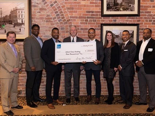 Valiant Cross Academy was honored at Max Credit Union's