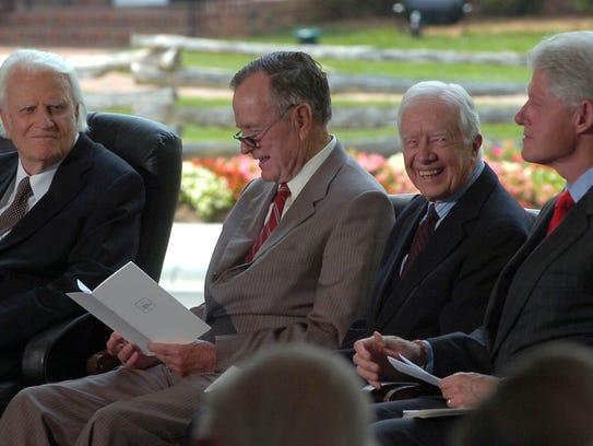 Billy Graham talks with former presidents Bush, Carter,