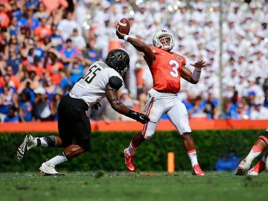 Florida quarterback Treon Harris (3) throws the ball