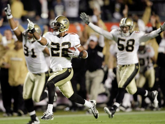 FILE - In this Feb. 7, 2010, file photo, New Orleans Saints cornerback Tracy Porter (22) reacts as he returns an interception 74 yards for a touchdown against the Indianapolis Colts during the second half of NFL football's Super Bowl XLIV in Miami. The Saints won 31-17. (AP Photo/Mike Grollm File)