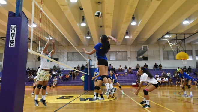 In this file photo, Notre Dame's Carlie Quinata (14) goes up for the kill against the George Washington Geckos during the 17th annual Shieh Invitational Volleyball Tournament Championship game at the George Washington High School gym in Mangilao on Aug. 14.
