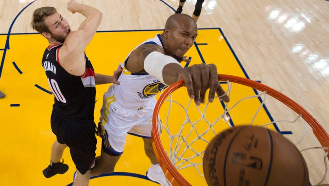 Dec. 11: The Golden State Warriors' David West dunks the ball against the Portland Trail Blazers at Oracle Arena. The Warriors won the game, 111-104.