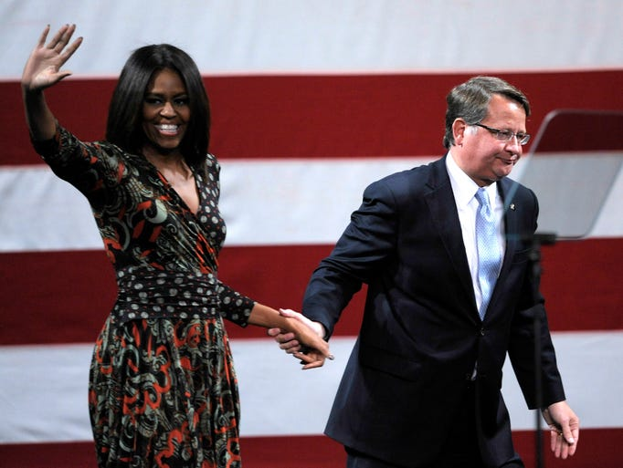 U.S. Rep. Gary Peters leads first lady Michelle Obama