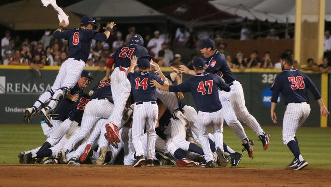 Arizona players celebrate after defeating Mississippi State 6-5 in 11 innings during an NCAA college baseball tournament super regional game in Starkville, Miss., Saturday, June 11, 2016.