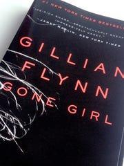 "Gillian Flynn, author of the New York TIme's best seller ""Gone Girl"", tapped former Burlington police detective Emmet Helrich for advice on police procedures for the book."