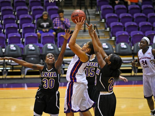 LSUA sophomore De'Shia Dillon (30, left) attempts to block a shot against NSU Saturday.