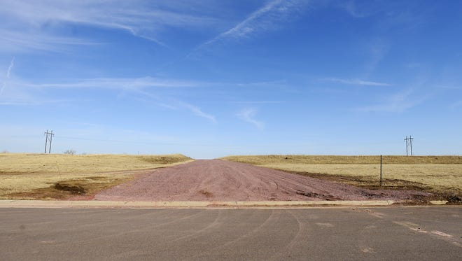 Access road connecting the Canterbury Heights development with Powder House Road in northeast Sioux Falls on March 11.