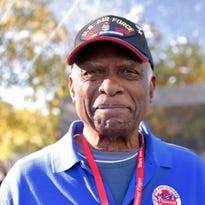 Korean War veteran Maxwell Shavers, left, and his brother Victor Shavers reunited during the Stars and Stripes Honor Flight. They are pictured here at the Korean War Memorial.