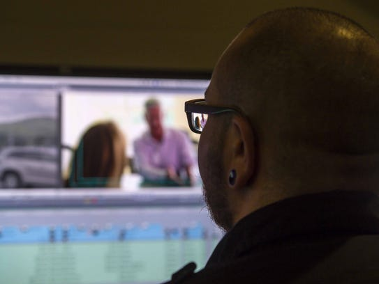 Production Technician Holt Albee edits an episode of