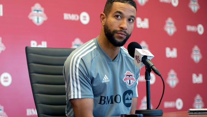 In this Nov. 13, 2019, file photo, Toronto FC soccer player Justin Morrow speaks to the media during an end of season availability in Toronto. A group of African American Major League Soccer players have formed a coalition to address systematic racism in their communities and bring about change within the league. The coalition is the result of an Instagram group formed after the death of George Floyd at the hands of Minneapolis police, which spawned a wave of nationwide protests against racism and policy brutality. Started by Toronto FC defender Justin Morrow, the group grew to some 70 MLS players, who decided to act and the Black Players Coalition of MLS was born.