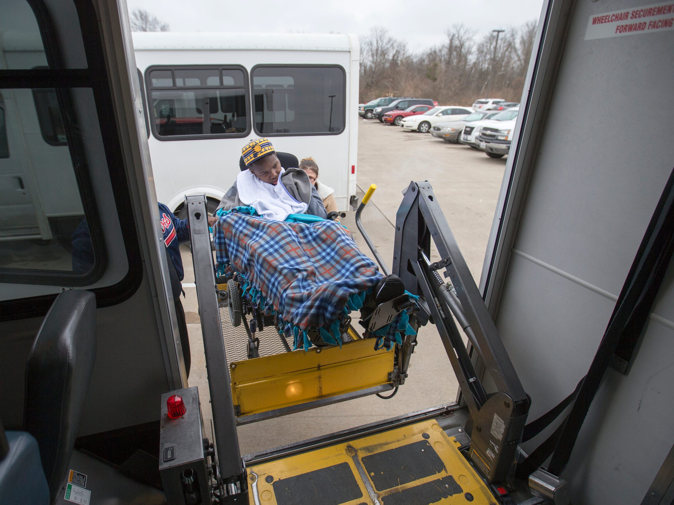 DeAndre Knox, 15, is loaded onto a van after treatment at Neuro Restorative, Carbondale, Ill., Thursday, January 21, 2016. Knox was shot in 2014, and has a long road of physical therapy ahead.