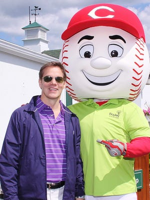 Bill Hemmer and Mr. Redlegs before the 11th annual George Knittle Memorial Golf Outing on May 19, 2014, at Western Hills Country Club.