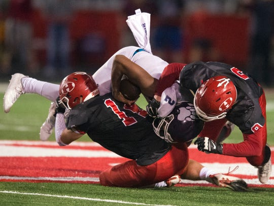 Sevier County's Cam Burden is sacked by Halls' Isaac