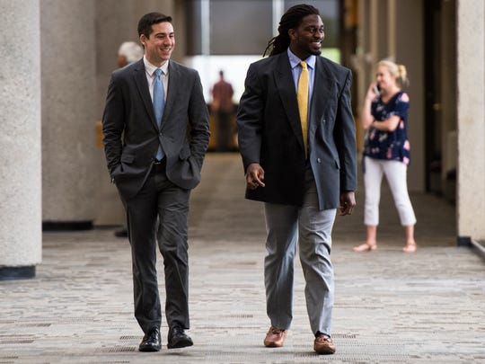 Former University of Tennessee linebacker A.J. Johnson, right, walks to the courtroom in Knox County Criminal Court on Wednesday, May 30, 2018.