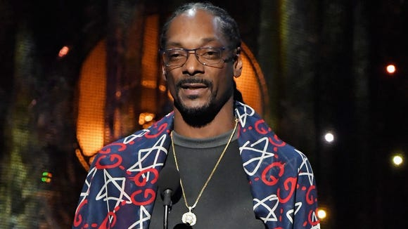 Rapper Snoop Dogg will host and produce a revival of