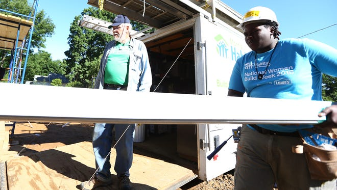 Roy Zaborowski, l, President of Blitz Home Builders during the Habitat for Humanity 10-Day Building Blitz to complete building of three homes in Mine Hill.  June 14, 2018. Mine Hill, NJ
