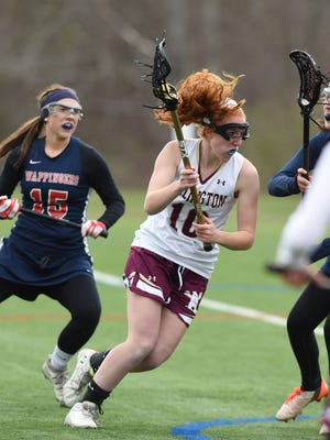 Arlington's Abby Carlin drives inside before attempting a shot against Wappingers during an April 2016 game.