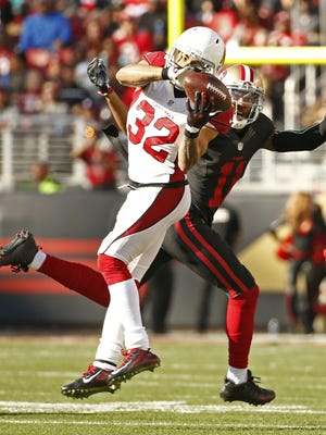 Arizona Cardinals Tyrann Mathieu intercepts a pass away from San Francisco 49ers Quinton Patton in the first half on Nov. 29, 2015 in Santa Clara, Calif.