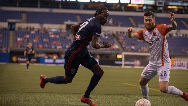 Nathan Lewis of the Indy Eleven competes against Blake Smith of FC Cincinnati at Lucas Oil Stadium on May 2, 2018.