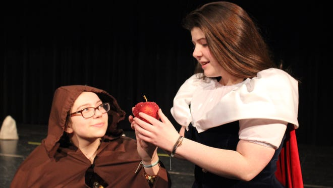 "Fox Valley Lutheran High School junior Brianna Neuberger, playing the Queen, and Elise Johnson in the role of Snow White, prepare for the school's production of ""Snow White and the Seven Dwarfs of the Black Forest."""
