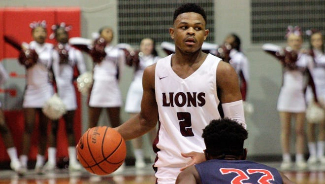 Senior guard Paul King's (2) clutch free-throw shooting helped Ouachita clinch playoff wins over West Monroe and Bonnabel.