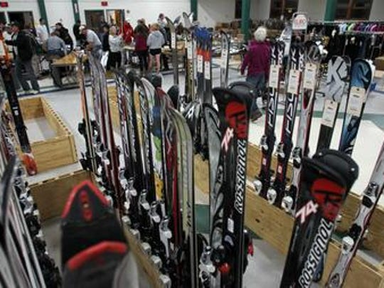 Hundreds of skis already stand in racks as people check in their ski gear, to be sold at the ski swap at East Gate Hall, in Marathon Park in Wausau.