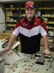 Clint Ewert of Team Whyachi stands with the Warrior Clan bots at Westar Manufacturing in Dorchester last month.