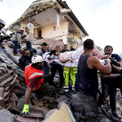 A woman is pulled out of the rubble following an earthquake