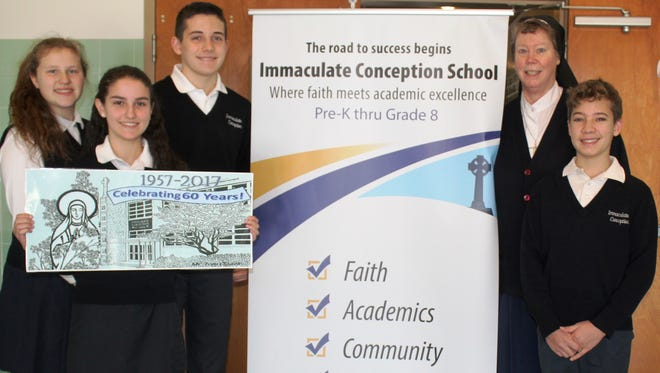 Principal Sr. Mary Chapman IHM joins with student council officers to promote the 60th anniversary of Immaculate Conception School in Somerville.