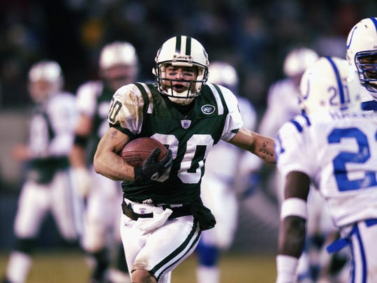 Wayne Chrebet of the Jets carries the ball during the AFC wild-card game against the Indianapolis Colts on Jan. 4, 2003.
