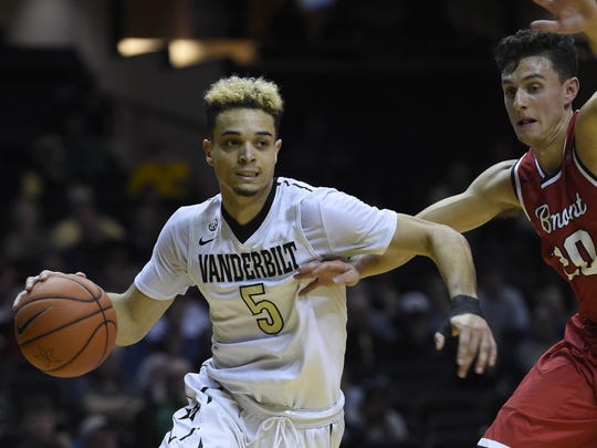 Vanderbilt guard Matthew Fisher-Davis (5) drives past