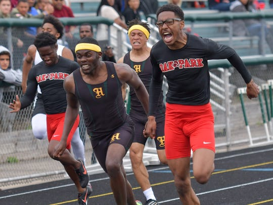 Harrison's Joe Stevens (left) was nosed out by Oak Park senior Donnie James (right) for first place in both the 100- and 200-meter dashes at the West Bloomfield regional meet.