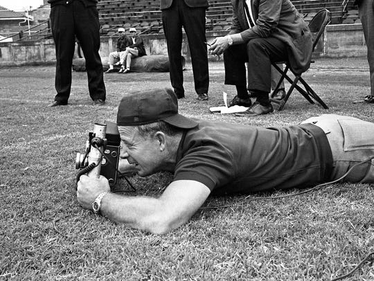 Photographer Jimmy Holt is in action during Vanderbilt's football team picture day Aug. 31, 1967, at Dudley Field.