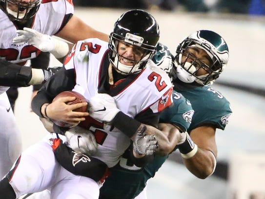 Atlanta quarterback Matt Ryan is sacked by Philadelphia's