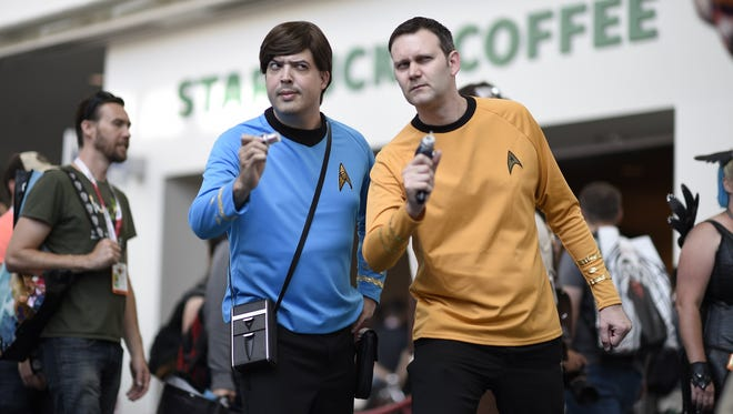 Two attendees at the 2015 Comic-Con dress up as Mr. Spock and Captain Kirk at the event.