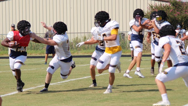 Defensive players try to track down a ball carrier during Stephenville High School's annual Blue/Gold Scrimmage Saturday.