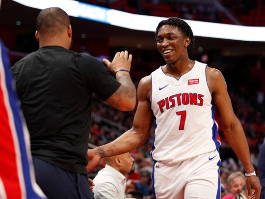 Stanley Johnson smiles as he walks to the bench during the fourth quarter of the Pistons' 110-87 win over the Bucks at Little Caesars Arena on Feb. 28, 2018.