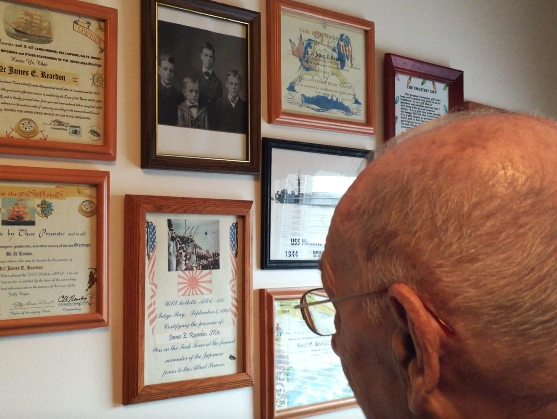 In his home, James Reardon displays certificates for