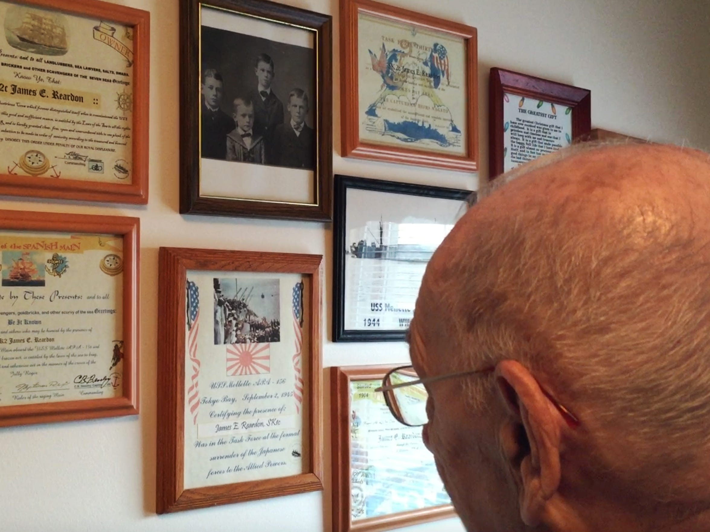In his home, James Reardon displays certificates for crossing the equator and the international dateline along with other naval awards.