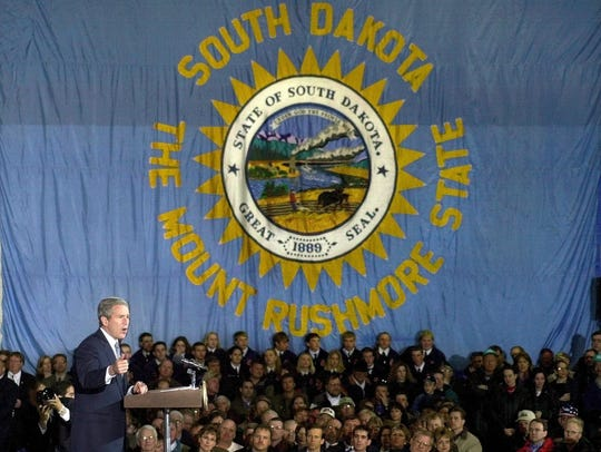 With a huge South Dakota state flag as a backdrop,