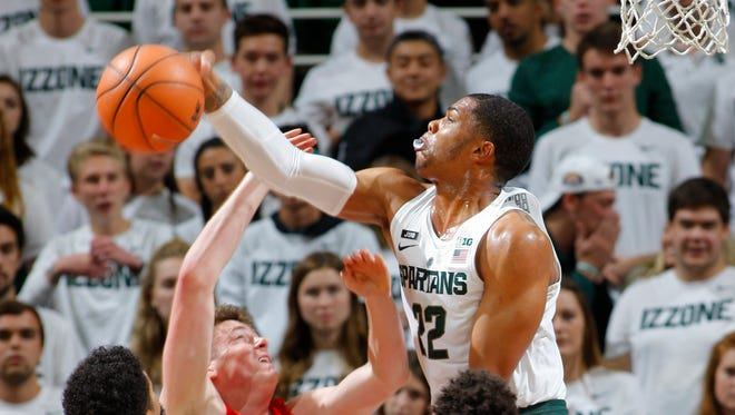 Michigan State's Miles Bridges, right, suffered a cut over his right eye in the first half but returned and finished with 19 points.