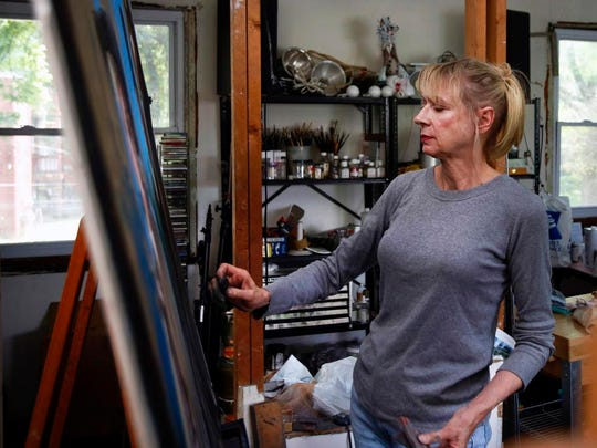 Gaela Erwin works in her Highlands' studio. Erwin just recently won a grant from the Joan Mitchell Foundation. July 18, 2015
