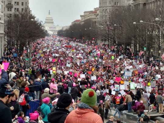Participants in the Women's March head down Pennsylvania