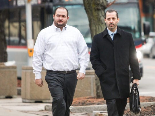 Joseph Ruff, left, enters federal court with his attorney Matt Parrinello on Dec. 5, 2014. Ruff pleaded guilty to illegal gambling, an extortion conspiracy and a money-laundering conspiracy. The extortion conspiracy involved NHL star Thomas Vanek.