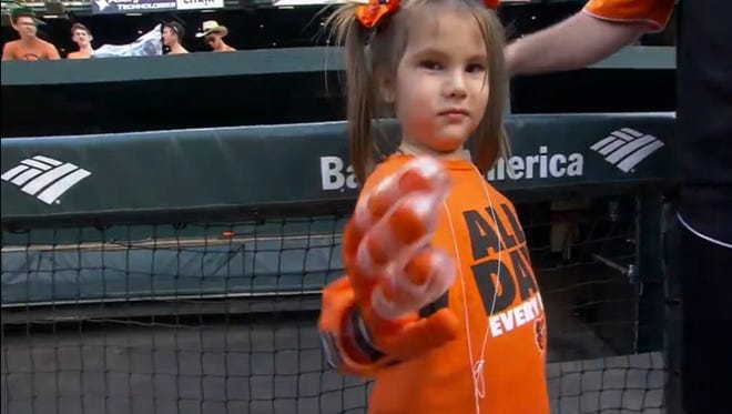 """Hailey Dawson, 5, with her """"Flexy-Hand 2,"""" which was developed by UNLV engineering students."""