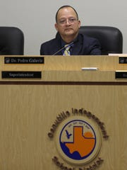 Canutillo Independent School District Superintendent Pedro Galaviz listens to a presentation at a school board meeting.