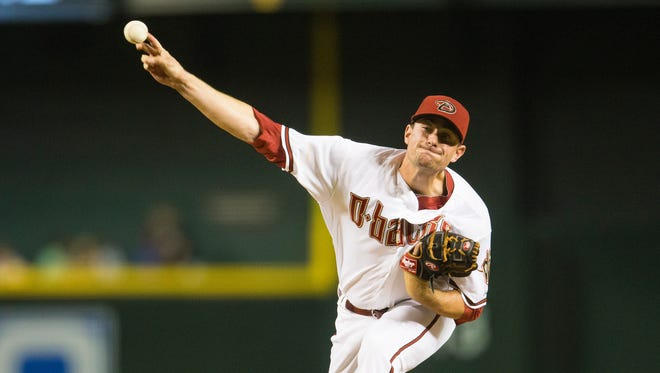 Diamondbacks pitcher Daniel Hudson delivers a pitch against the San Francisco Giants at Chase Field April 6, 2015.